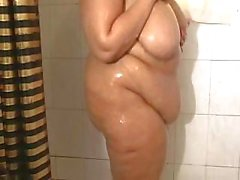 Big chubby with big tits showers and shows off on her webcam
