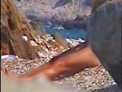 Hidden cam of a Nude beach showing this couple sunbathing