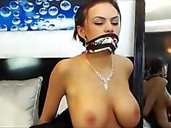 busty babe is tied up trying to escape