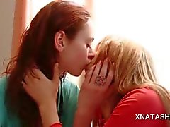 Lesbos Natasha Shy and Ivana licking breasts by the window