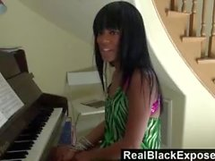 RealBlackExpo - Tila Flame shows off her tits and butt while playing piano.