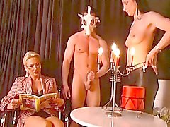 Nasty mature teacher and two lovely slaves on side