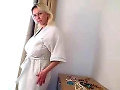 boobsy mature lady plays in the kitchen and shower