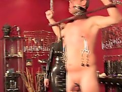 British dominatrix with gagged and bound sub