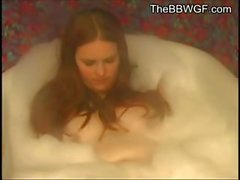 Fat Chubby Redhead Ex Gf taking a bubble bath and showing her Tits