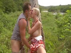 Hot busty blonde chick swallows his cock and gets nailed in the ass in the woods