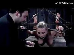 Hogtied slut with gag gets toyed