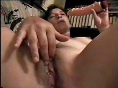 Russian brunette blows cock and uses a dildo and eats cum