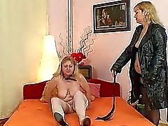 Amateur wives fucking each other with a rubber coc