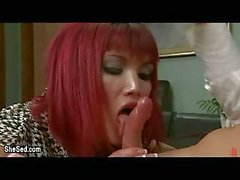 Redhead tranny gives blowjob in office
