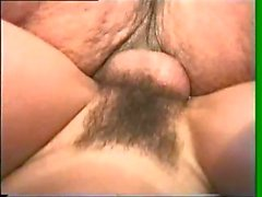 Mature brunette is giving her mature fat dude some head and riding cock