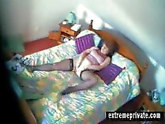 Spy vid my mom fingering in her bedroom