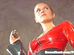 Slave young girl bounded and whipped by latex ladies
