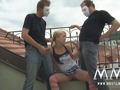 Blonde teen giving 2 guys a blowjob on the terrace