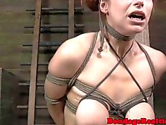 Bondage slut sub Bella Rossi pussy lips clamp
