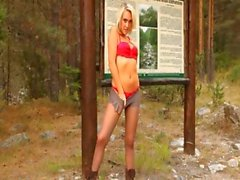 Blonde model in pantyhose teasing forest