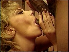 Tattooed blonde enjoys foreplay with black lover