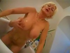 Blond mom and Son in Bathroom