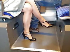 crossed legs with sheer pantyhose on train