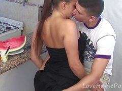 Brunette gives head and fucks in a kitchen