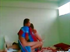Ethnic couple having real sex on bed