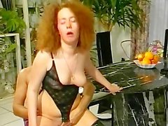 Redhead getting fucked on the kitchen table