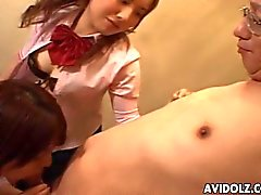 Three cute Japanese teens suck of an older man