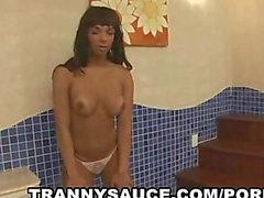 tasty tanned tranny babe tugging on her hard cock